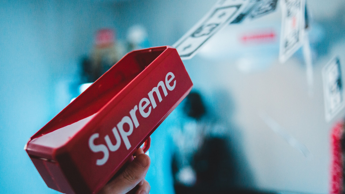 rectangular red supreme container with money