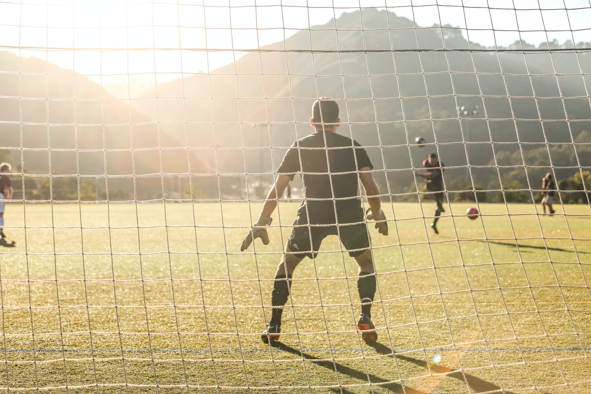 man playing football on a field